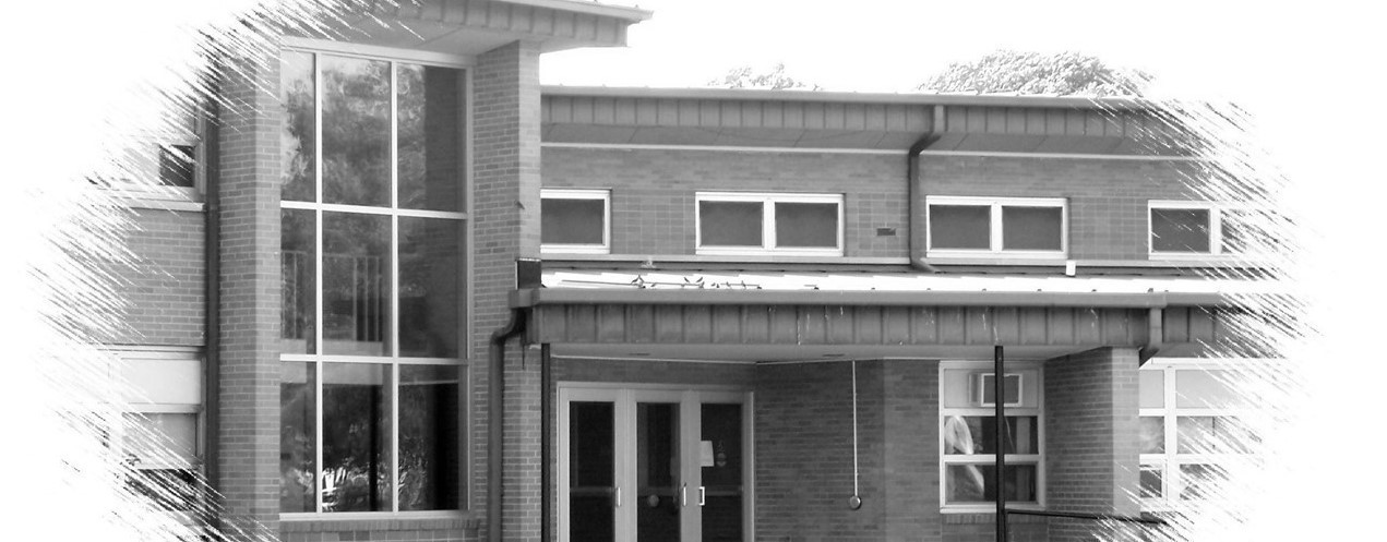 black and white image of the front of the school