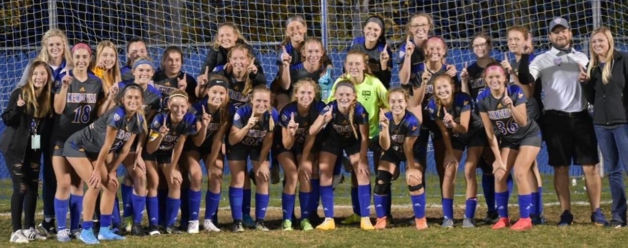girls soccer team posing in front of goal: WBL champs
